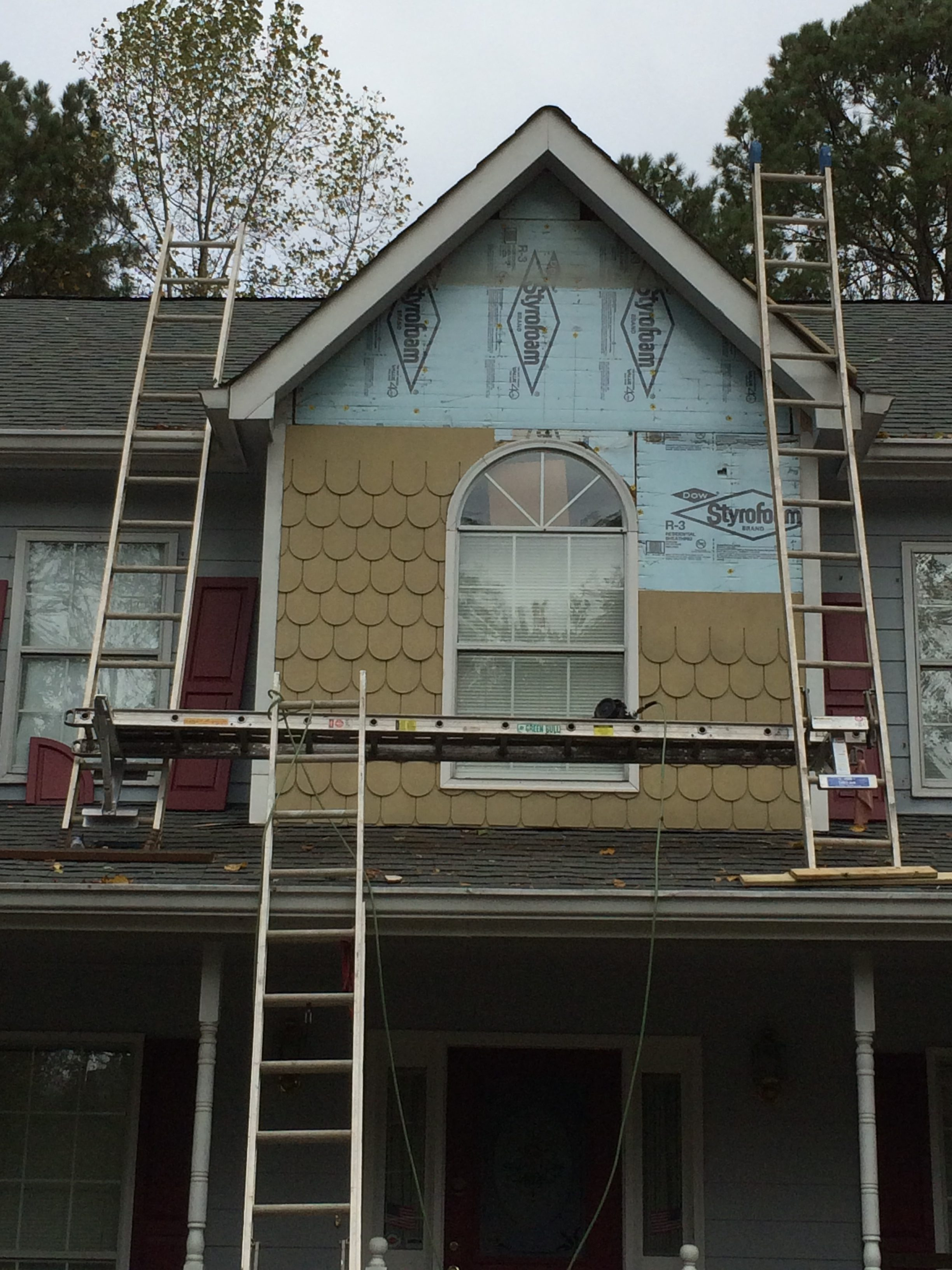 fish scale siding in progress