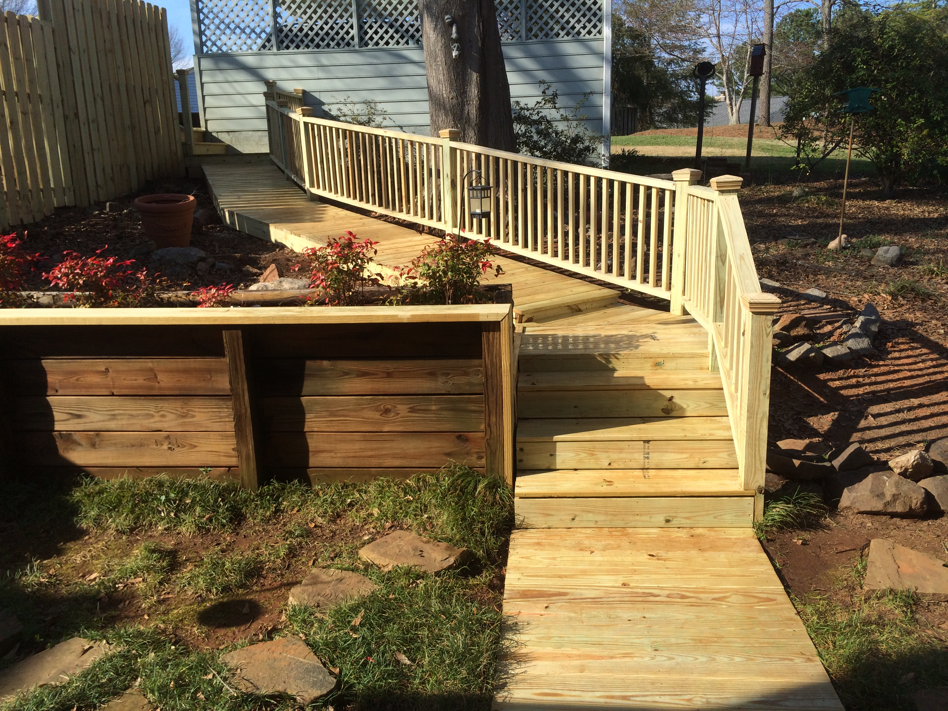 wood walkway with handrail